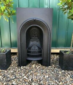 A Beautiful Victorian Antique Cast Iron Arch Insert Fireplace