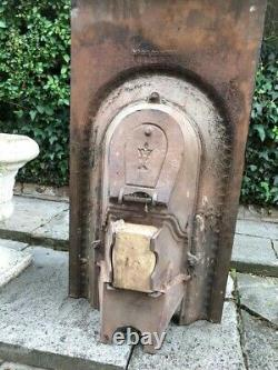 A Lovely Mid Victorian Antique Cast Iron Arch Insert Fireplace
