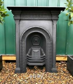 A Lovely Victorian Antique Cast Iron Arch Detailed Combination Mantle Fireplace