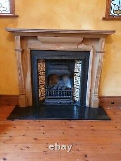 Antique original very rare curved tiled cast iron fireplace with wood surround