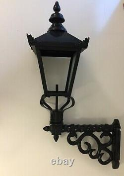 Cast wall lamp wrought iron ex display, 2 available