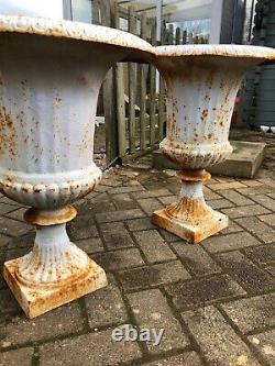 PAIR of rusty white campagna urns cast iron urns