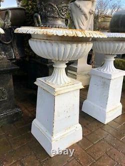 Set of four cast iron urns & plinths Victorian style cast iron urns