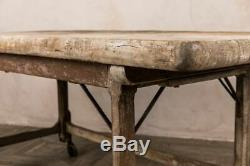 Vintage Butchers Block Table With Oak Base With Cast Iron Wheels